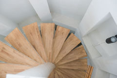 Wooden spiral stair from house modern interior royalty free stock photography