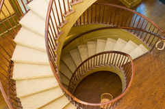 Wooden spiral staircase. Overlooking a wooden spiral staircase royalty free stock photography