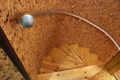 Wooden spiral staircase. An iron handrail, a steep slope Royalty Free Stock Photography