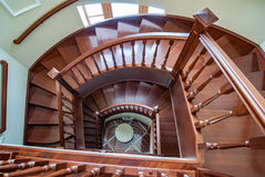 A wooden spiral staircase. View from above stock images