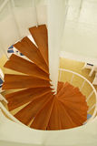 Wooden spiral stairway Stock Photo