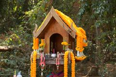 Wooden Spirit House. / House of the guardian spirit stock photo