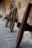 Wooden spoke wheels Stock Images
