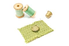 Wooden spools of thread, button and thimble Royalty Free Stock Photography