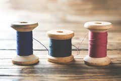 Wooden spools of thread close-up. Selective focus. Rendered image.  stock images