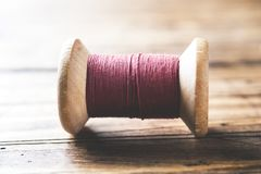 Wooden spools of thread close-up. Selective focus. Rendered image.  royalty free stock photography
