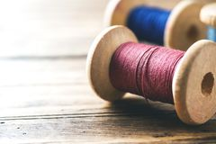 Wooden spools of thread close-up. Selective focus. Rendered image. Copy space. Wooden spools of thread close-up. Selective focus. Rendered image Copy space royalty free stock image
