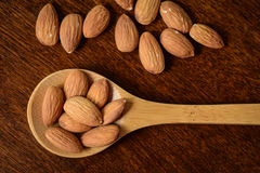 Wooden Spoon with Almonds Stock Photos