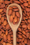 Wooden spoon with almonds Stock Photography