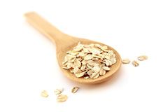 Wooden Spoon And Oatmeal Stock Images