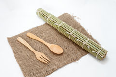 Wooden spoon and  bamboo mats on sack Royalty Free Stock Photography