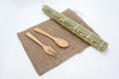 Wooden spoon and  bamboo mats on sack Royalty Free Stock Image