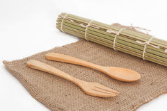 Wooden spoon and  bamboo mats on sack Royalty Free Stock Images