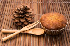 Wooden spoon and banana cake Royalty Free Stock Image