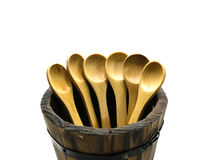 Wooden spoon in barrel on isolate background. Wooden spoon in barrel on isolate Royalty Free Stock Photography