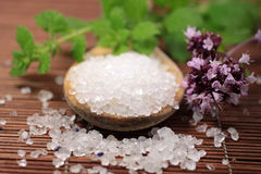 Wooden spoon with bath salt Royalty Free Stock Images