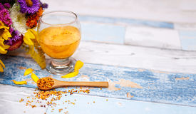 Wooden spoon with bee pollen Royalty Free Stock Image