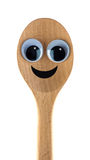 Wooden spoon. A  wooden spoon with big eyes and a smile on a white background Stock Photos