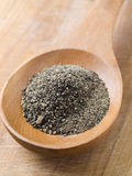Wooden spoon and black pepper Royalty Free Stock Photography