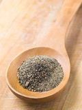 Wooden spoon with black pepper Royalty Free Stock Photos