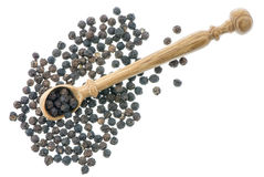 Wooden spoon with black peppers Stock Photography