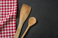 Wooden spoon on a blackboard Royalty Free Stock Photo