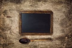 Wooden spoon and Blackboard Royalty Free Stock Photography