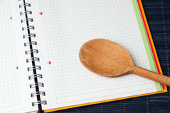 Wooden Spoon on Blank Menu Stock Image
