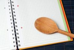 Wooden Spoon on Blank Menu Stock Image
