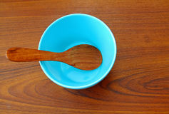 Wooden spoon in blue bowl Royalty Free Stock Photography