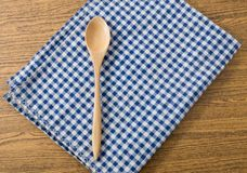 Wooden Spoon on Blue and White Checked Napkin Royalty Free Stock Photo
