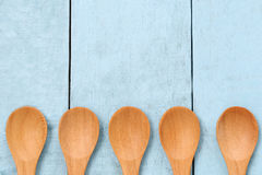 Wooden spoon on blue wood floors. Wooden spoon on blue wood floors,concept of utensils and cooking Stock Photography