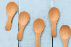 Wooden spoon on blue wood floors. Wooden spoon on blue wood floors,concept of utensils and cooking Stock Image