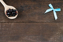 Wooden spoon with blueberries and bow Stock Image