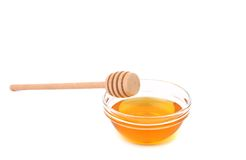 Wooden spoon on bowl with honey. Royalty Free Stock Photo