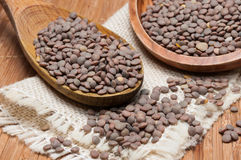 Wooden spoon and bowl with lentils Stock Photography
