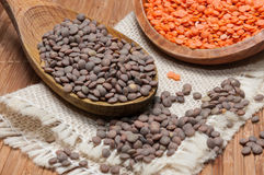 Wooden spoon and bowl with lentils Stock Photos