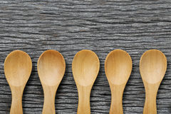 Wooden spoon on brown wood floors. Wooden spoon on brown wood floors,concept of utensils and cooking Stock Photos