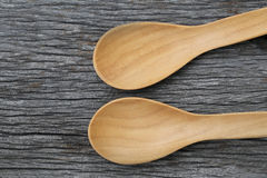 Wooden spoon on brown wood floors. Wooden spoon on brown wood floors,concept of utensils and cooking Royalty Free Stock Images
