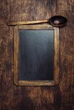 Wooden spoon and chalkboard Royalty Free Stock Images