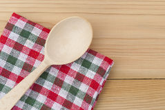 Wooden spoon and a checkered napkin Royalty Free Stock Photo