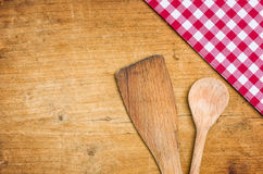 Wooden spoon with a checkered tablecloth Stock Photo