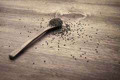Wooden spoon with chia seeds royalty free stock photo