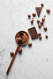 Wooden spoon with chocolate Stock Photography