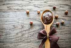 Wooden spoon of chocolate cream with hazelnuts Royalty Free Stock Photography