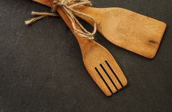 Wooden spoon. Close up on black background royalty free stock photography