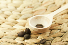 Wooden spoon and coffee beans Royalty Free Stock Photography