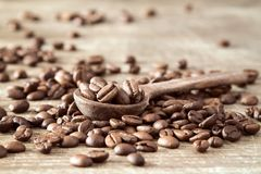 Wooden spoon with coffee beans Royalty Free Stock Photography