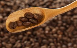 Wooden spoon with coffee grains Royalty Free Stock Photos