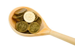 Wooden spoon with coins Royalty Free Stock Images